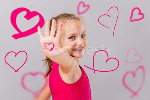 Saint valentin souriant cute fille rose Photo stock © gabor_galovtsik