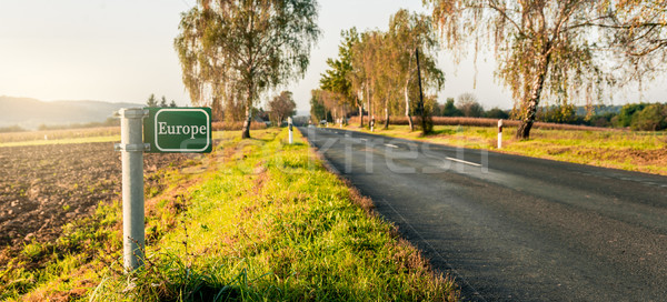 green signboard at the roadside in an autumn landscape.  Stock photo © gabor_galovtsik