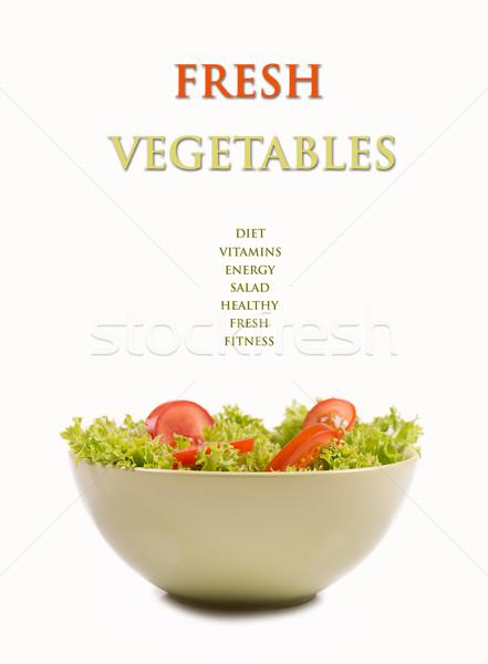 Verse groenten vers saladeschaal geïsoleerd foto achtergrond Stockfoto © gabor_galovtsik