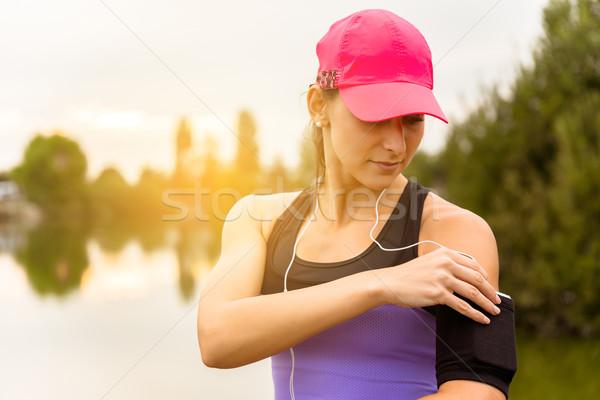 Futó nő zene fut telefon víz Stock fotó © gabor_galovtsik