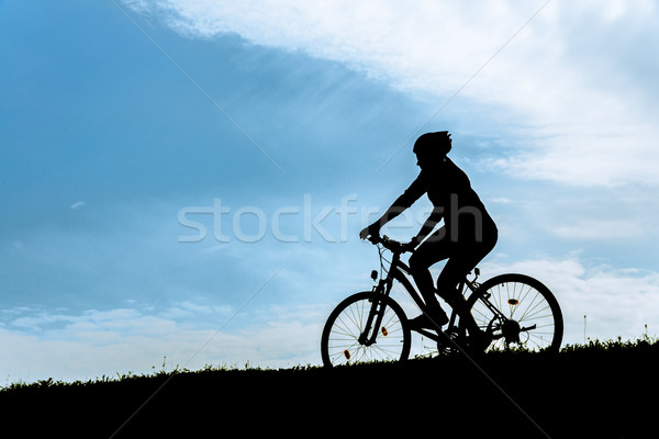 Stock photo: Silhouette of the cyclist at dawn.