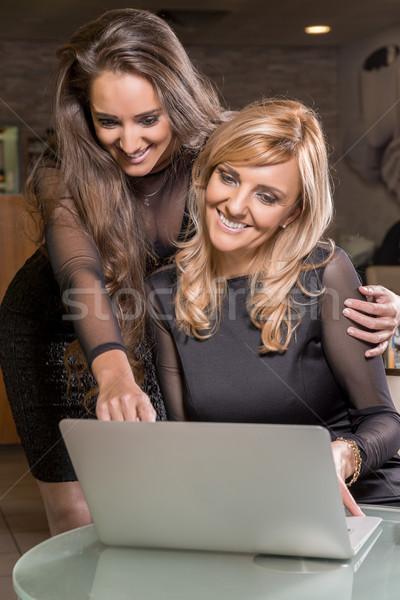 Friends with laptop. Stock photo © gabor_galovtsik