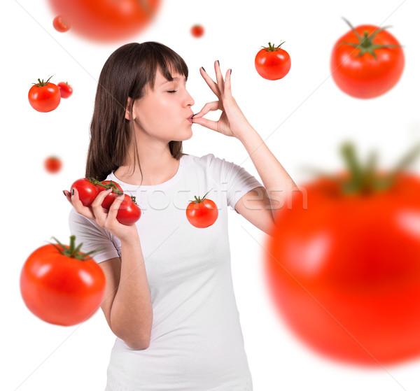 Beautiful woman and tomatoes Stock photo © gabor_galovtsik