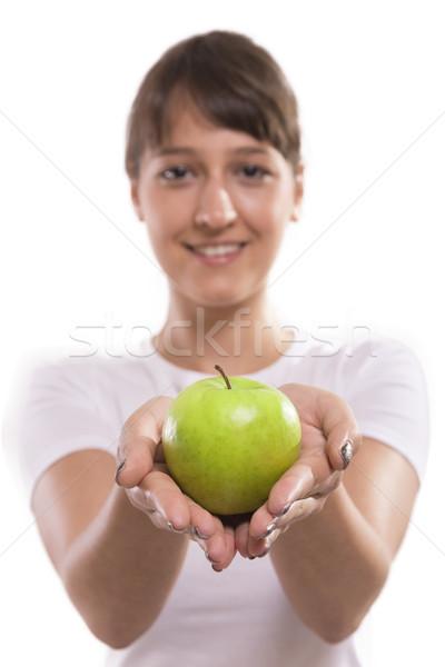 green apple in woman hands Stock photo © gabor_galovtsik