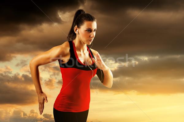 Woman running at sunset. Stock photo © gabor_galovtsik