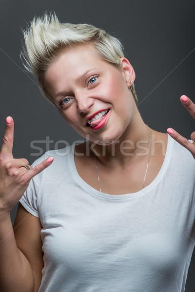 Vicces arc gyönyörű fiatal nő készít stúdiófelvétel arc Stock fotó © gabor_galovtsik