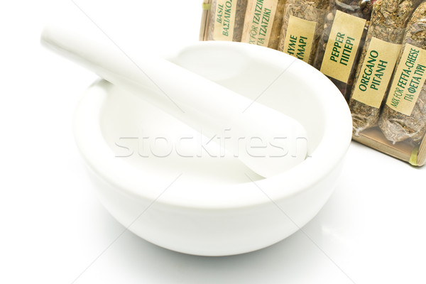 Different spices with porcelain mortar and pestle  Stock photo © gavran333