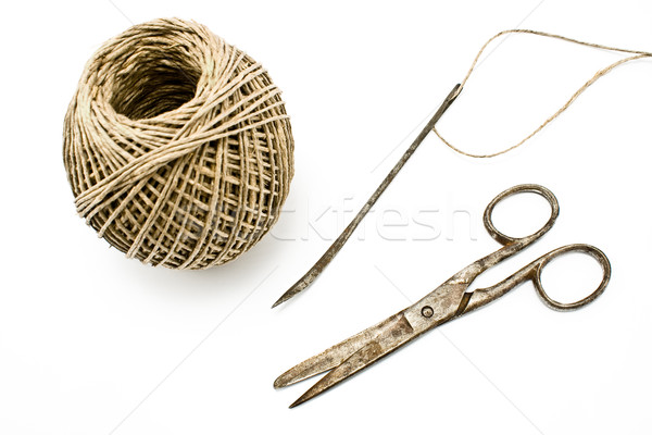 Old rusty scissors and needle with clew- sewing tools Stock photo © gavran333