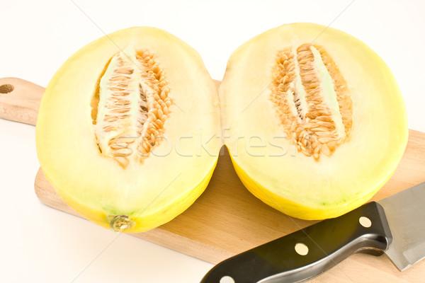 Cantaloupe melon sliced on wooden board Stock photo © gavran333