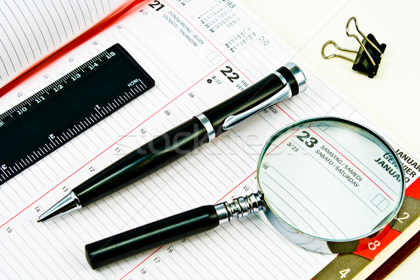 Pen and Agenda with a tools of punctuality Stock photo © gavran333