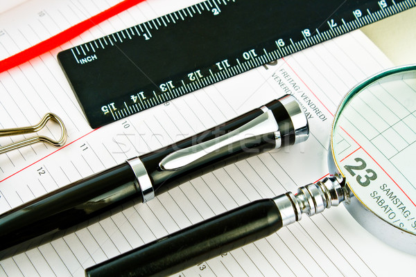Pen on Agenda with tools of punctuality Stock photo © gavran333