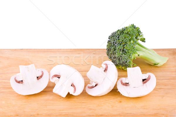 Champignon brocoli fraîches champignons bois planche à découper Photo stock © Gbuglok