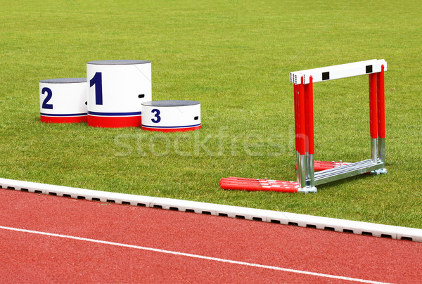 Track lanes, winner's podium, hurdles Stock photo © Gbuglok