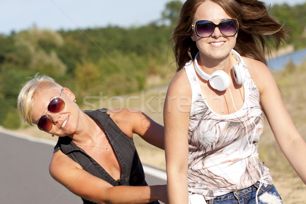 Two young fitness girls in outdoor activity Stock photo © Gbuglok
