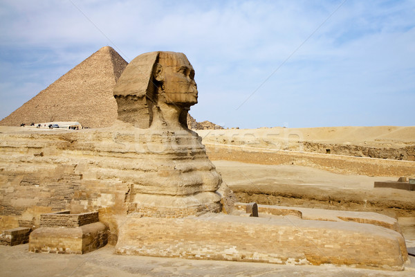 Egyptian Sphinx with pyramid in Giza Stock photo © Gbuglok