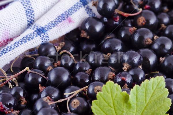 Black currants in the kitchen Stock photo © Gbuglok