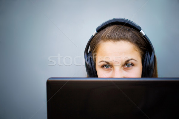 Young girl with headphones Stock photo © Gbuglok