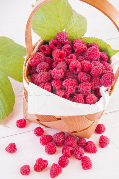 Raspberries in a punnet Stock photo © Gbuglok