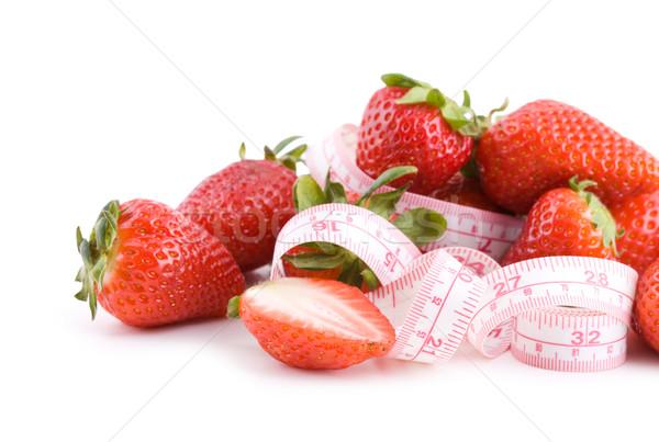 S'adapter fraises fraîches isolé blanche Photo stock © Gbuglok