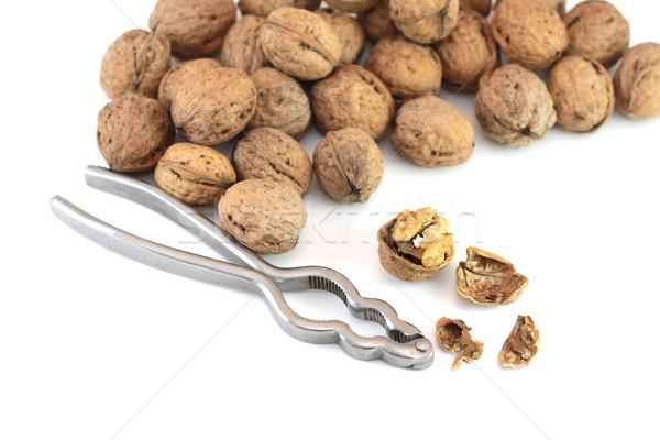 Walnuts with nutcracker Stock photo © Gbuglok
