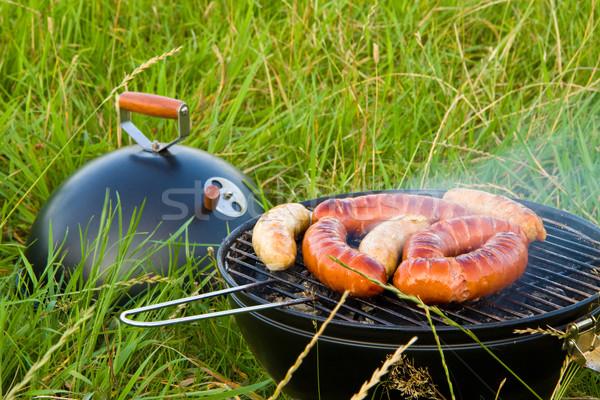 Barbecue saucisses grillés extérieur herbe verte herbe Photo stock © Gbuglok