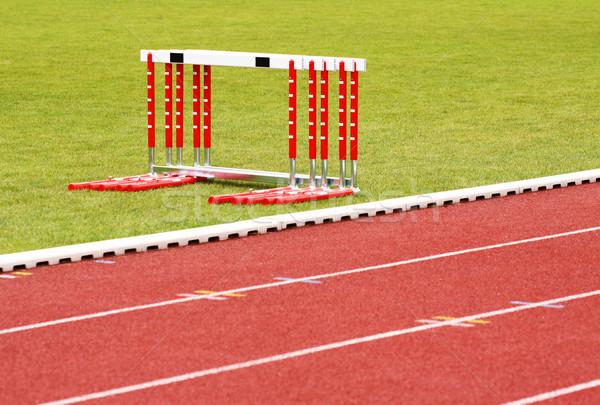 Track and hurdles Stock photo © Gbuglok