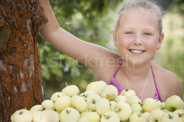Stock photo: Nice young girl with apples