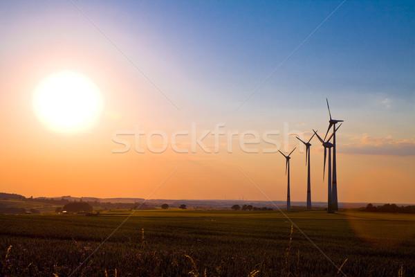 Windmills at sunset Stock photo © Gbuglok