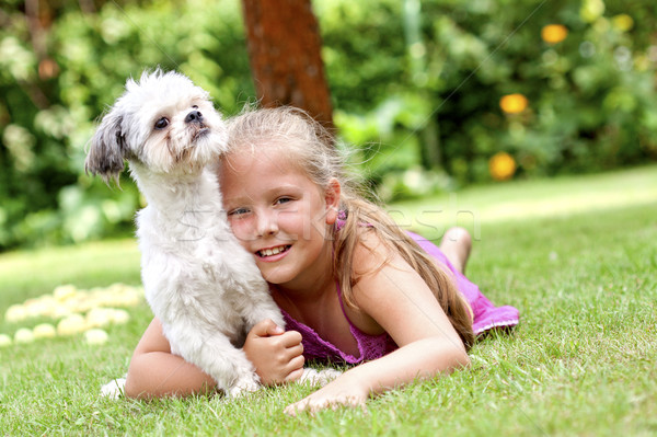 Young girl with her dog Stock photo © Gbuglok