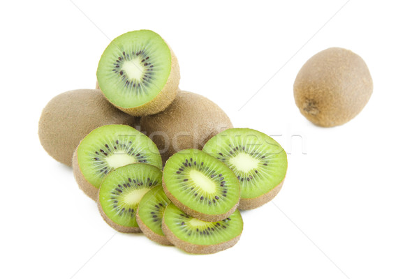 Kiwi tranches fraîches vert isolé blanche Photo stock © Gbuglok