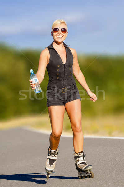 Young fitness woman on rollers Stock photo © Gbuglok