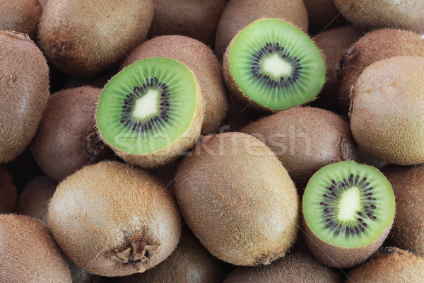 A few fresh kiwi fruits Stock photo © Gbuglok