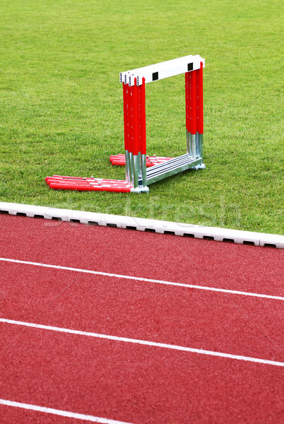 Track and hurdles Stock photo © Gbuglok