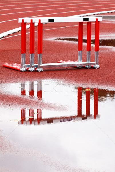 Akadályok kifutópálya nedves esős nap víz Stock fotó © Gbuglok