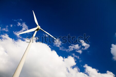 Windmill against a blue sky and white clouds Stock photo © Gbuglok