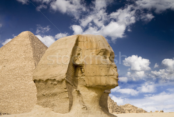 Egyptian Sphinx with pyramid Stock photo © Gbuglok