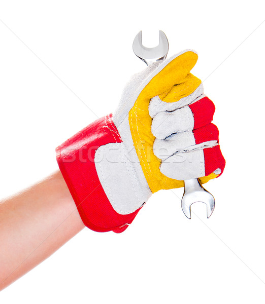 gloved hand with wrench Stock photo © GekaSkr