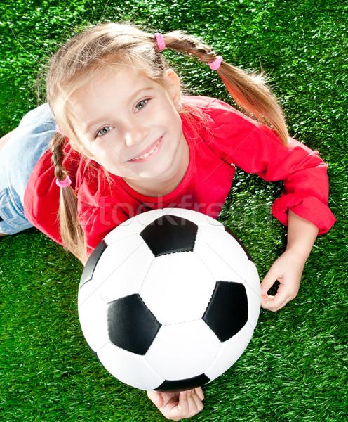 Menina futebol little girl verde gramado feliz Foto stock © GekaSkr