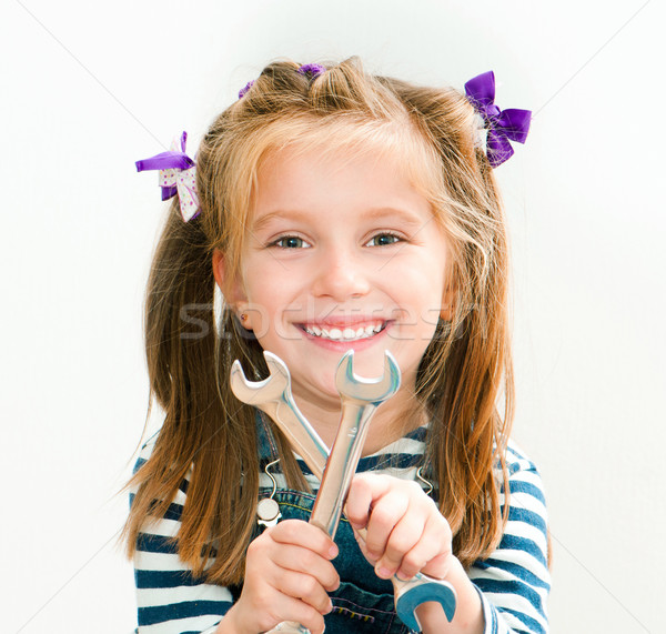 smiling girl with spanners Stock photo © GekaSkr