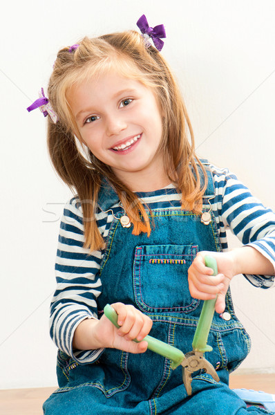 smiling girl with pliers Stock photo © GekaSkr