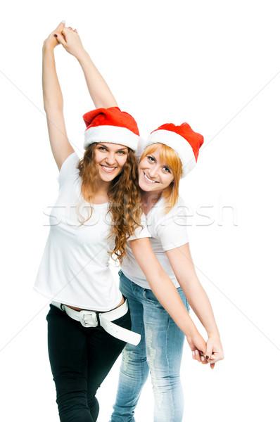 Dziewcząt Święty mikołaj hat dwa piękna odizolowany Zdjęcia stock © GekaSkr