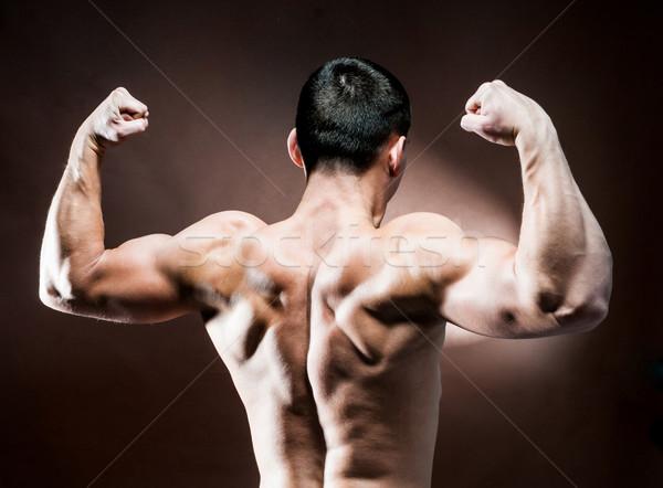 Muscular masculin înapoi maro om fitness Imagine de stoc © GekaSkr