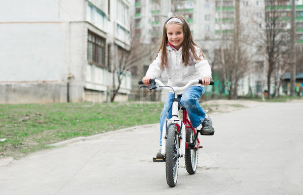little girl with her bicycle Stock photo © GekaSkr