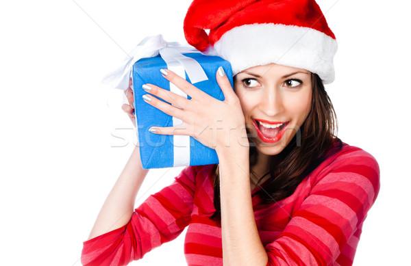 Dziewczyna Święty mikołaj hat prezenty piękna dziewczyna niebieski Zdjęcia stock © GekaSkr
