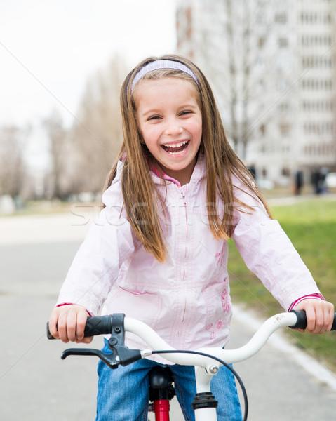 девочку велосипед мало улыбаясь девушки дороги Сток-фото © GekaSkr