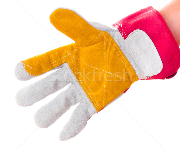 gloved hand with hacksaw Stock photo © GekaSkr