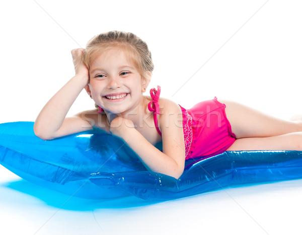 Aranyos kislány felfújható matrac úszik öltöny Stock fotó © GekaSkr