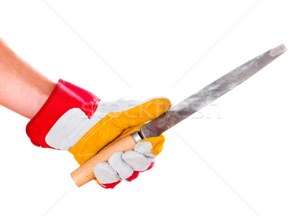 Stock photo: gloved hand with file