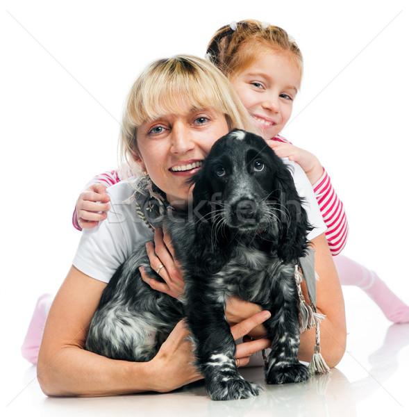 Mãe little girl cão branco mulher família Foto stock © GekaSkr
