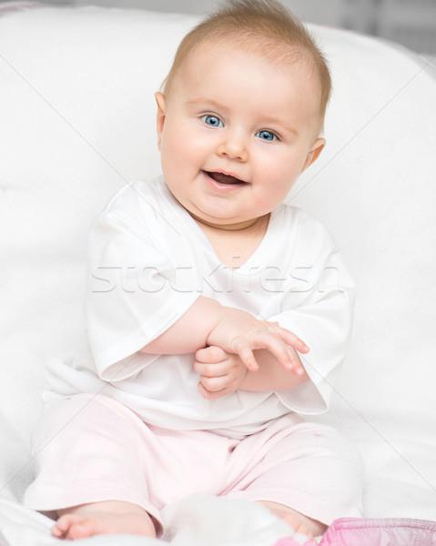 Adorável bebê sorridente olhando fundo diversão Foto stock © GekaSkr